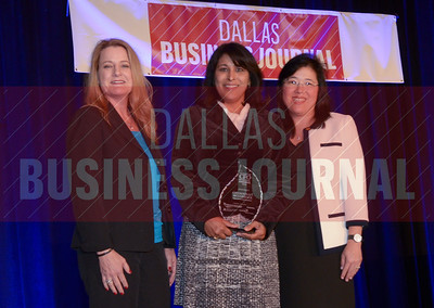 Chandrika T. McCormack, CFO, Main Event Entertainment, center, receives her award from Sharon Lukich and Lisa Ong of Dallas CPA Society.