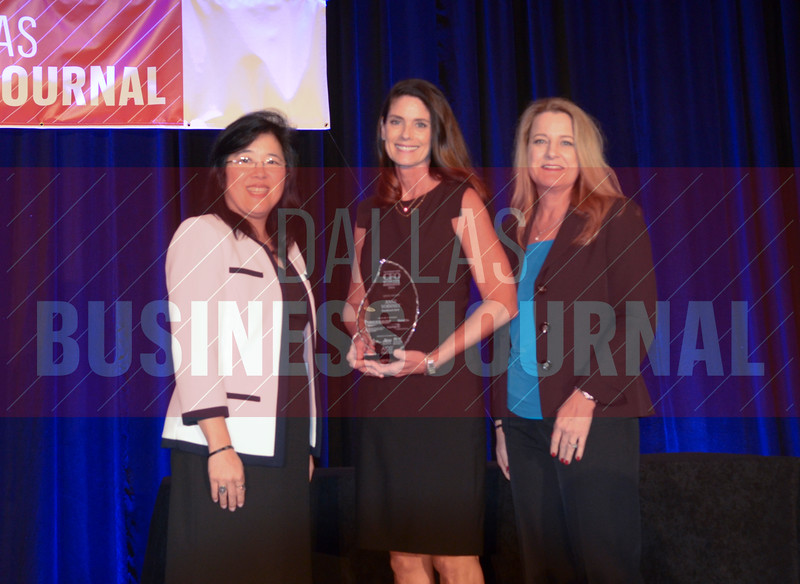 Anne Voisinet, Senior Vice President/CFO, Benchmark Bank, center, receives her award from Lisa Ong and Sharon Lukich of Dallas CPA Society.
