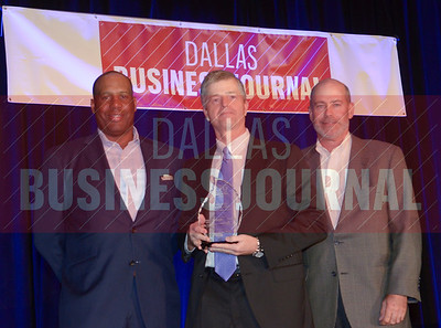 Allen L. West, CMA, Chief Analytics Officer, Lockton Dunning Benefits, center, receives his award from Tony Banks and Larry king of ACG DFW.