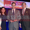 Gary Golden, Executive Vice President – Finance & Operations, Bottle Rocket, center, receives his award from Marie Diaz and Mark Galvan of Pursuit of Excellence.