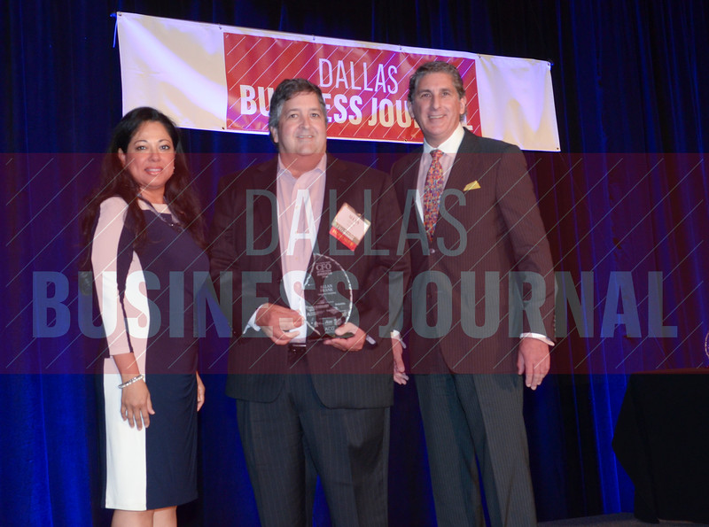 Allan Frank, CFO, HomePro Operating, center, receives his award from Marie Diaz and Mark Galvan of Pursuit of Excellence.