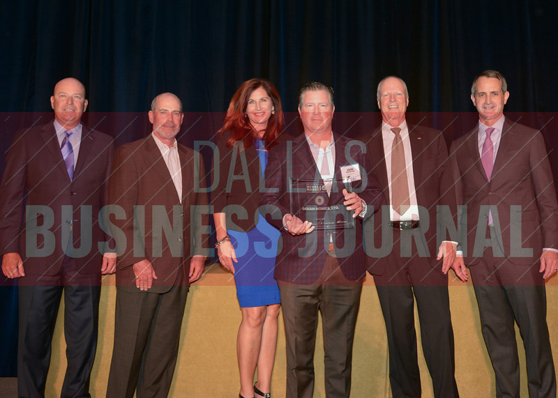 John Winniford, CEO of Gehan Homes, center, picks up the homebuilders 8th place  Middle Market 50 award from Dickie Heathcott, partner Crowe Horwath, Larry King, president of the board of directors at ACG DFW, Kathy Schrock, managing partner of The CFO Suite, David Moore, president UMB Bank, Jon Henderson, Dallas managing partner Polsinelli, from the left.
