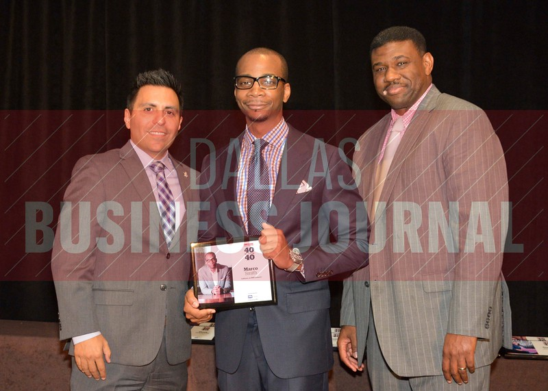 Marco Smith receives his award from Jesus Miranda, Campus President universal Technical Institute, left and Kevin Davis, Director of EMBA Recruiting and External Relations at TCU.