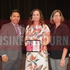 Amy Tharp receives her award from Jesus Miranda, Campus President universal Technical Institute, left and Dr. Suzanne Carter, Executive Director of the Neeley EMBA program and Professor of Practice in Strategy at TCU.