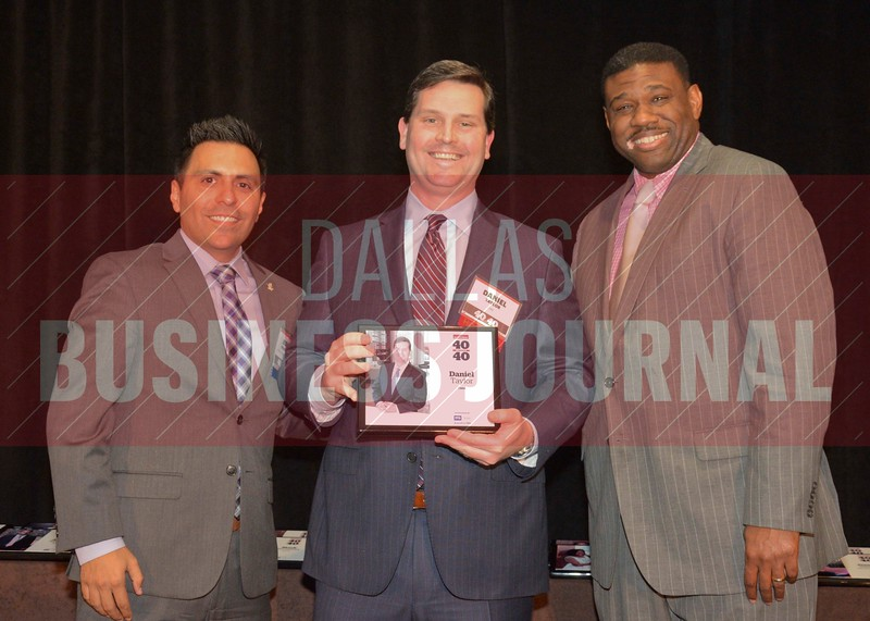 Daniel Taylor receives his award from Jesus Miranda, Campus President universal Technical Institute, left and Kevin Davis, Director of EMBA Recruiting and External Relations at TCU.