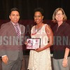Kamecia Lambert receives her award from Jesus Miranda, Campus President universal Technical Institute, left and Dr. Suzanne Carter, Executive Director of the Neeley EMBA program and Professor of Practice in Strategy at TCU.