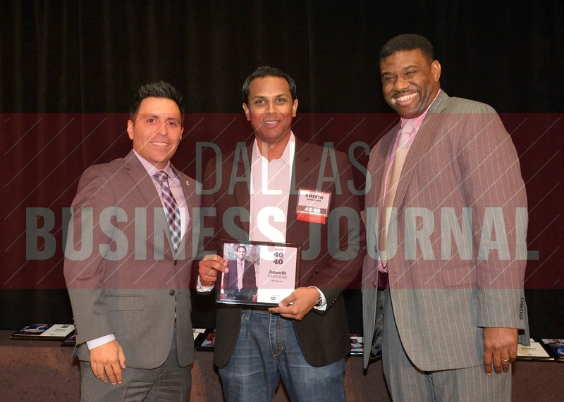 Ameeth Sankaran receives his award from Jesus Miranda, Campus President universal Technical Institute, left and Kevin Davis, Director of EMBA Recruiting and External Relations at TCU.