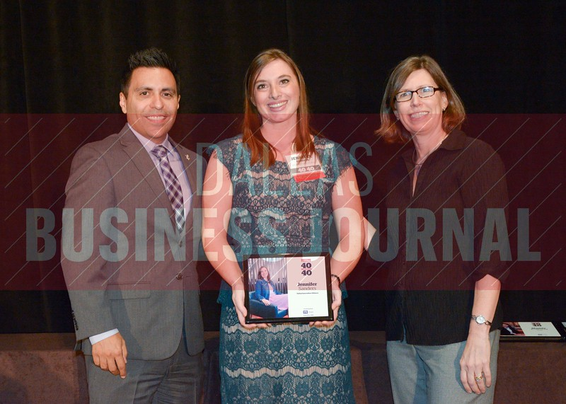 Jennifer Sanders receives her award from Jesus Miranda, Campus President universal Technical Institute, left and Dr. Suzanne Carter, Executive Director of the Neeley EMBA program and Professor of Practice in Strategy at TCU.
