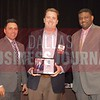 Craig Wilson receives his award from Jesus Miranda, Campus President universal Technical Institute, left and Kevin Davis, Director of EMBA Recruiting and External Relations at TCU.