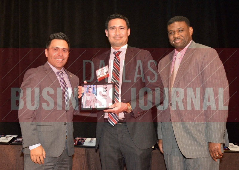 Harry Lake receives his award from Jesus Miranda, Campus President universal Technical Institute, left and Kevin Davis, Director of EMBA Recruiting and External Relations at TCU.