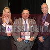 J.C. Gonzalez receives his award from Kalyn McKittrick, Director of Marketing and Engagement, TCU Neeley Executive Education, left and Jim Roach, Executive Director of TCU Neeley Executive Education Center.