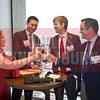 Lisa Lake, David Tillotson and Ryan Friend toast 40 Under 40 honoree Harry lake. second from left.