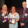 Jennifer Chandler receives her award from Kalyn McKittrick, Director of Marketing and Engagement, TCU Neeley Executive Education, left and Jim Roach, Executive Director of TCU Neeley Executive Education Center.