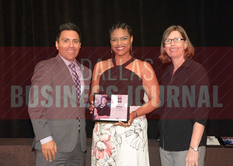 Yulise Waters receives her award from Jesus Miranda, Campus President universal Technical Institute, left and Dr. Suzanne Carter, Executive Director of the Neeley EMBA program and Professor of Practice in Strategy at TCU.