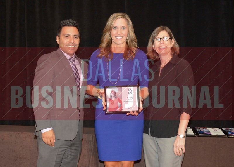 McKay Heim receives her award from Jesus Miranda, Campus President universal Technical Institute, left and Dr. Suzanne Carter, Executive Director of the Neeley EMBA program and Professor of Practice in Strategy at TCU.