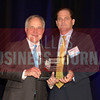 Bernard Uechtritz, right, accepts his Land Transaction, Broker of the Year award from Bill Shaddock of Best Real Estate Deals presenting sponsor Capital Title.
