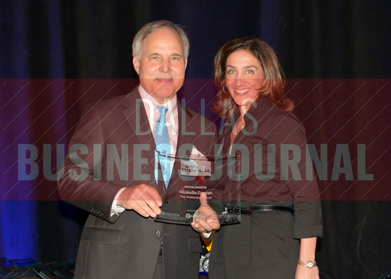 Michelle Caplan, right, accepts her Retail, Broker of the Year award from Bill Shaddock of Best Real Estate Deals presenting sponsor Capital Title.