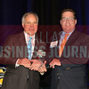 Will Balthrope right, accepts his Multifamily, Broker of the Year award from Bill Shaddock of Best Real Estate Deals presenting sponsor Capital Title.