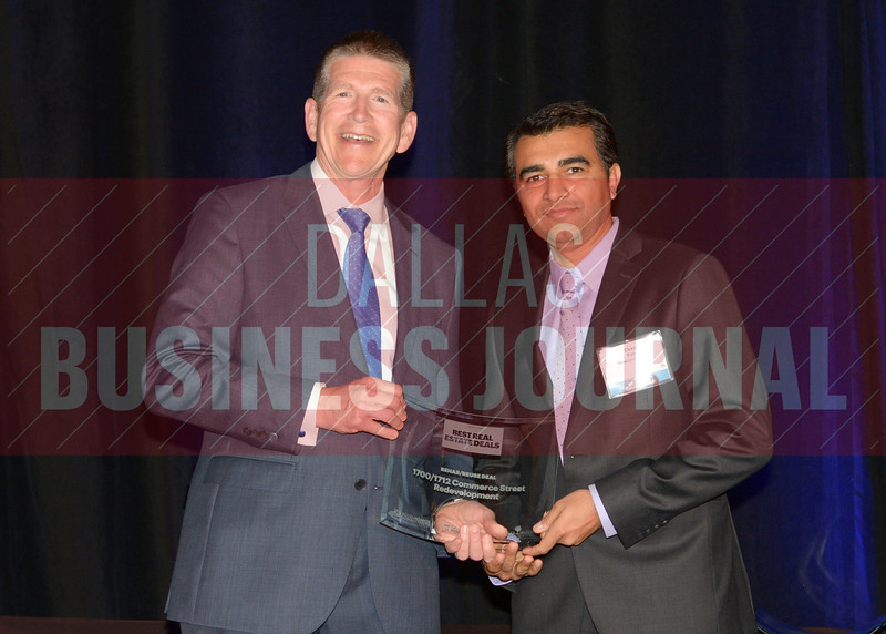 Chirag Patel, right, accepts the best Rehab/Reuse deal for the 1700/1712 Commerce Street project from Bret Robertson of presenting sponsor CF Accountants & Consultants.