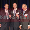 Josh McArtor and Jack Fraker accept their Investment Sales, Broker of the Year award from Bill Shaddock of Best Real Estate Deals presenting sponsor Capital Title.