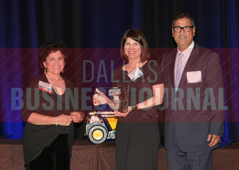 Caroline Perel and David Perel accept the Most Creative Financing Deal award for Aloft + Element at Dallas Love Field form Allison Thompson of presenting sponsor The City of Cedar Hill.