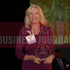 Barbara Fasola CEO, Careington International Corporation,  with her Women in Business award.
