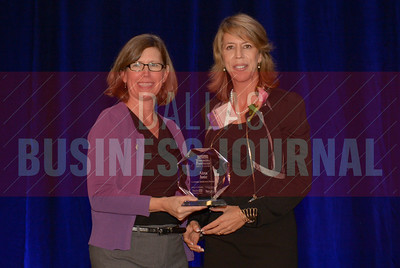 Aiza Jose Senior Manager, Gresham, Smith and Partners, right,  recives her Women in Business award from Dr. Suzanne Carter Executive Director, Executive MBA Program and Professor of Professional Practice in Strategy TCU.