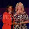 Paula Fenner Director of Catering and Conference Services, The Adolphus, right, receives her Women in Business award from Noelle LeVeaux CMO, Dallas Convention and Visitors Bureau.