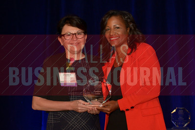 Andrea Gates Managing Director, Rosewood Mansion on Turtle Creek, left, receives her Women in Business award from Noelle LeVeaux CMO, Dallas Convention and Visitors Bureau.