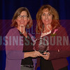 Kathy Rismiller President of Optical Laboratory Software Solutions, Essilor of America, right, recives her Women in Business award from Dr. Suzanne Carter Executive Director, Executive MBA Program and Professor of Professional Practice in Strategy TCU.