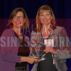 Susan Walmesley Vice President Sales & Marketing, Topgolf, right, recives her Women in Business award from Dr. Suzanne Carter Executive Director, Executive MBA Program and Professor of Professional Practice in Strategy TCU.