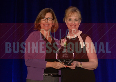 Debbie Mrazek Owner, The Sales Company, right, recives her Women in Business award from Dr. Suzanne Carter Executive Director, Executive MBA Program and Professor of Professional Practice in Strategy TCU.