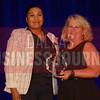 Kea Garrett CEO, Preparing People Barber Styling College, left, recives her Women in Business award from Kim Speairs Director of Client Services, Balcom Agency.