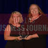 Beth Bowman President and CEO, Greater Irving-Las Colinas Chamber of Commerce, Irving Economic Development Partnership, right, recives her Women in Business award from Kim Speairs Director of Client Services, Balcom Agency.