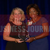 A. Shonn Brown Partner Lynn Pinker Cox & Hurst LLP, right, recives her Women in Business award from Kim Speairs Director of Client Services, Balcom Agency.