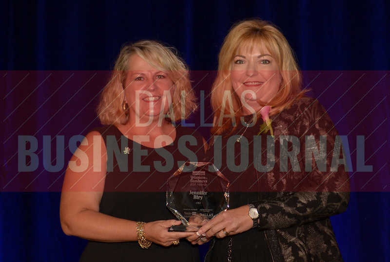 Jennifer Biry Senior Vice President, AT&T, right, recives her Women in Business award from Kim Speairs Director of Client Services, Balcom Agency.