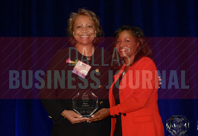 Mary German Senior Vice President – Operations, Arlington Convention & Visitors Bureau, left, receives her Women in Business award from Noelle LeVeaux CMO, Dallas Convention and Visitors Bureau.