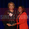 Mary German Senior Vice President – Operations,<br /> Arlington Convention & Visitors Bureau, left, receives her Women in Business award from Noelle LeVeaux CMO, Dallas Convention and Visitors Bureau.