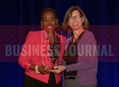 Evelyn Henry Miller CFO, TDIndustries, left, recives her Women in Business award from Dr. Suzanne Carter Executive Director, Executive MBA Program and Professor of Professional Practice in Strategy TCU.