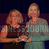 Sally Bane Director, Plano Economic Development, right, receives her Women in Business award from Kim Speairs Director of Client Services, Balcom Agency.