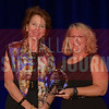 Merrimac Dillon President, The Pillow Bar, left, recives her Women in Business award from Kim Speairs Director of Client Services, Balcom Agency.