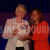 Sue Trizila President and CEO, Wyndham Jade, left, receives her Women in Business award from Noelle LeVeaux CMO, Dallas Convention and Visitors Bureau.