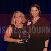 Amanda Austin Owner, Dallas Comedy House, right, receives her Women in Business award from Kim Speairs Director of Client Services, Balcom Agency.