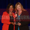 Dusti Groskreutz General Manager, Reunion Tower, right, receives her Women in Business award from Noelle LeVeaux CMO, Dallas Convention and Visitors Bureau.