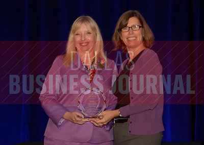 Vicky Gunning Dallas Office Managing Partner, Locke Lord LLP, left, recives her Women in Business award from Dr. Suzanne Carter Executive Director, Executive MBA Program and Professor of Professional Practice in Strategy TCU.