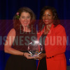 Maura Allen Gast Executive Director, Irving Convention & Visitors Bureau, left, receives her Women in Business award from Noelle LeVeaux CMO, Dallas Convention and Visitors Bureau.