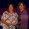 Lynda Harrell Founder and CEO, G Systems, L.P., left, recives her Women in Business award from Dr. Suzanne Carter Executive Director, Executive MBA Program and Professor of Professional Practice in Strategy TCU.