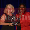 Angela Berry-Roberson Director of Diversity and Contract Compliance, Ferrovial Agroman US, right, recives her Women in Business award from Kim Speairs Director of Client Services, Balcom Agency.