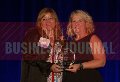 Sarah Chapin CEO, Hail Merry, left, recives her Women in Business award from Kim Speairs Director of Client Services, Balcom Agency.