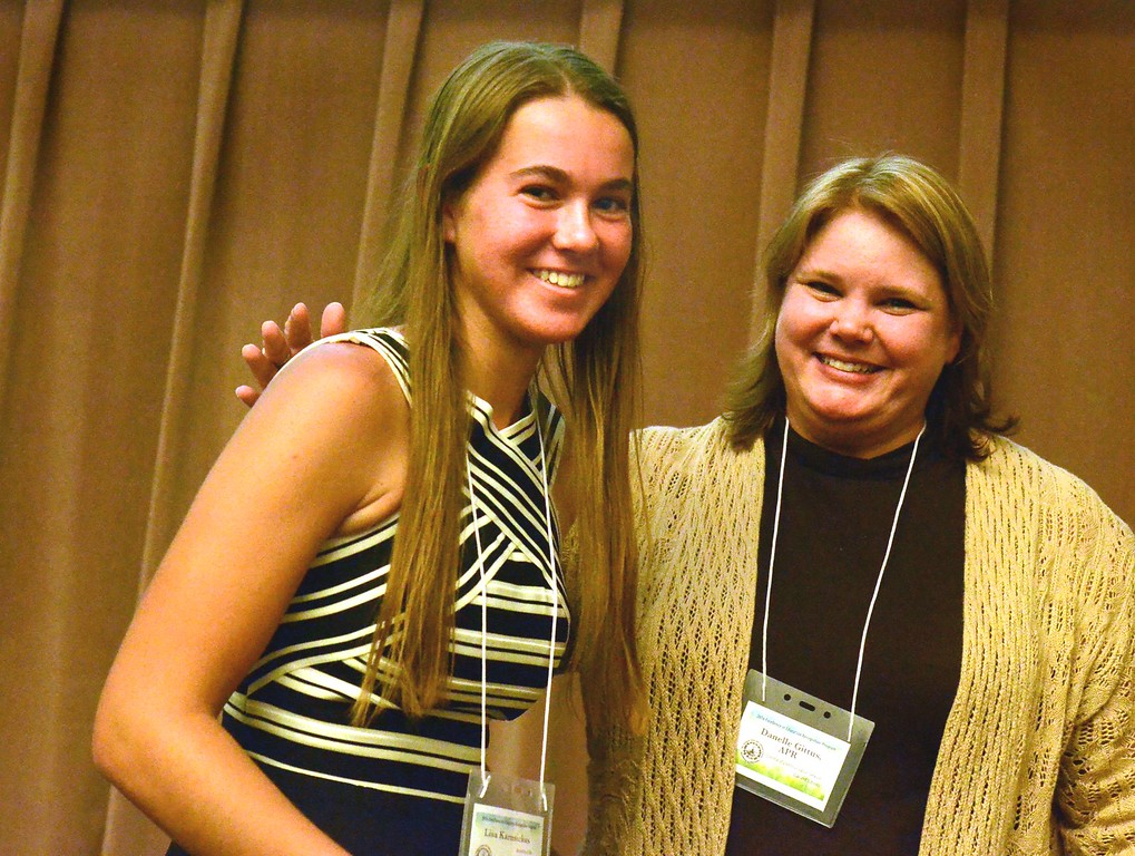 . Lisa Kamsickas receives her 3rd place award from Danelle Gittus at the 2016 Excellence in Education awards at the Oakland Schools building. Lisa goes to the Academy of the Sacred Heart.  Thursday, April 22, 2016.  Tim Thompson-The Oakland Press